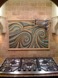 glass tile custom mosaic centerpiece installed in a kitchen backsplash in north ina