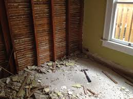 first the plaster wall was removed from the guest bedroom exposing the wood lathe from the wall on the opposite side this would be become our guest