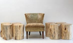 above handmade in new mexico a tree trunk stool is made of reclaimed pine and has felt feet it measures approximately 19 inches tall and is from 10 to 12