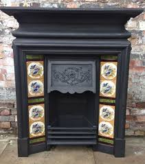an original cast iron edwardian fireplace this antique tiled combination has an elaborate decorative design