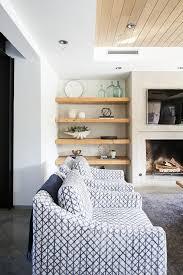 light wood floating shelves in living room nook