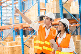 Male And Female Industrial Engineers Looking To Direction With