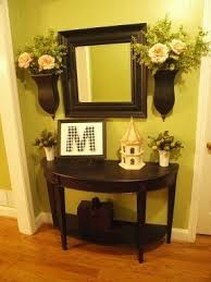 entryway furniture with mirror. okay so not the flowers or birdhouse thingbut entryway furniture with mirror i