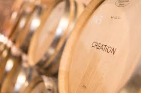 stacked oak barrels maturing red wine. The Art Of Winemaking: Barrel Maturation Stacked Oak Barrels Maturing Red Wine