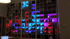 book shelf lighting. so this guy yvind berntsen has programed a game tetris into his bookshelf which use colorful led lights to make up the shapes book shelf lighting
