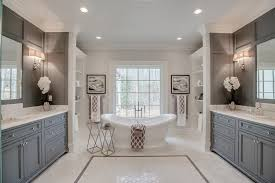 traditional master bathroom with built in shelving and freestanding tub
