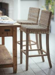A stylish and robust tall teak framed bar stool with natural rattan seat.  They are a great addition to your kitchen or dining room.