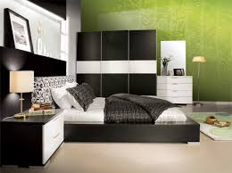 Bedroom:Amazing Black Bedroom Furniture Ideas With Floral Green Wallpaper  Also White Bedding Sets Plus