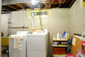unfinished basement lighting ideas. Before Makeover Small Basement Laundry Room Design With Rack For Detergent Storage In The Corner Plus Exposed Concrete Wall Ideas Unfinished Lighting