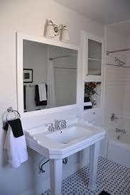 hall bath marble basket weave tile floor heavy cast iron porcelain kohler tub with