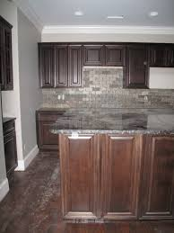 fabulous dark wood kitchen cabinet set with grey stones slate backsplash added large kitchen island brown wood panels as decorate in country kitchen designs