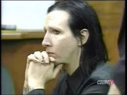 marilyn manson appears in court with his hands folded without makeup