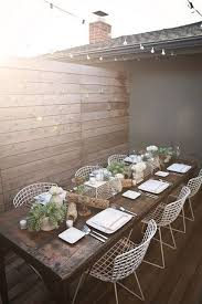 wouldn t this be a beautiful e for an outdoor dinner party with frineds i love the heavy rustic table paired with the white wire chairs