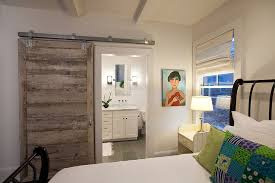 bedrooms girl bedroom with barn sliding door and white comfy bed also green pillows near