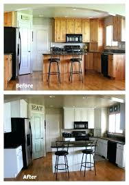 white painted kitchen cabinet reveal with before and after photos painted wood cabinets before and after