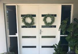 how to hang wreaths and stockings from glass doors