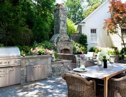 outdoor kitchens with fireplace. Simple With Stone Outdoor Kitchen Fireplace Botanical Decorators Olney  MD For Kitchens With