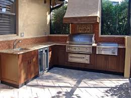 modern outdoor kitchen kits with wooden cabinet and marble top