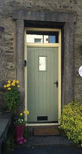 Cottage front door with fanlight and stone frame in Windermere