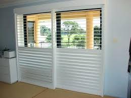patio door shutters roller shades for sliding glass doors cafe plantation roman hurricane panels
