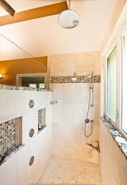 warm and light colored walk in shower with accentuated niches