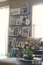 Decorating with pictures-easy diy picture ledges
