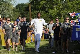 lennox torch. lewis carried the torch with pride through south east london park as sun bore lennox