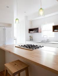 wood countertop in white kitchen