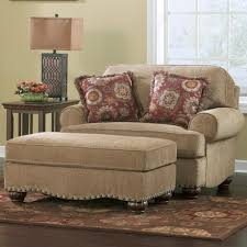 modern living room interior decoration beige fabric accent chair and half with ottoman red flower fabric