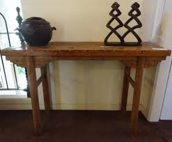 antique chinese bleached altar table with round legs and carved spandrels 19th century
