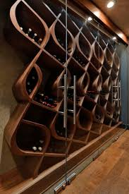 This wine cellar style is known as the Q Curve and holds approximately 380  bottles within curved wood wine racks. This one-of-a-kind Archite ...