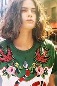 Lexi Smith 27 in a Gucci embroidered T shirt with snake flower.