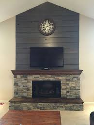 fireplace diy makeover old barnwood shiplap cleaned up and stained gray brown and airstone in spring creek and autumn mountain mixed