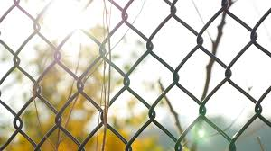 chain link fence background.  Fence Chainlink Fence In Sharp Focus With Soft Background Of Green Tree And  Sunlight Stock Video Footage  Videoblocks Inside Chain Link Fence Background C