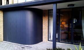 sliding garage doorsSliding garage doors  wooden  automatic  curved  THE CLIEVEDEN