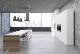 Concrete Kitchen Interior With A Concrete Floor White Cabinets