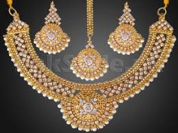 pearls golden jewellery set with matha patti in stan