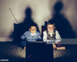 kids watching tv at night. two focused young nerds watching late night television kids tv at s