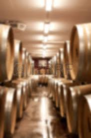 stacked oak barrels maturing red wine. Stock Photo - Wine Barrels In Cellar. Cavernous Cellar With Stacked Oak For Maturing Red Wine.
