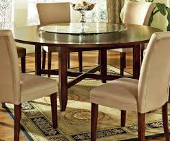 elegant dining room with avenue 72 inch round dining table light brown upholstered dining chairs and light brown wooden floors