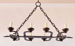 antique french iron chandelier with hand forged fleur de lis on the ends 3 000