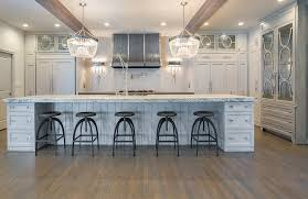 gray kitchen with clear beaded chandeliers