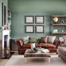 relaxed country living room with botanical wallpaper