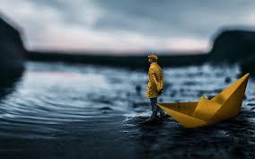4k lonely man coast paper ship creative