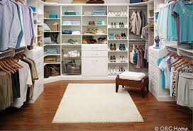 a visual divide between his and hers closet areas in a walk in closet columbus