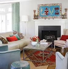 set one rug diagonally atop or even overhanging the base rug for added visual interest