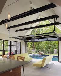 gl patio garage doors living room eclectic with painted ceiling upholstered dining side chairs