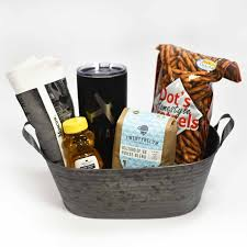 our places you ll far go gift basket has an array of favorite local treats along with a white moscow london paris fargo tee and a black go far yeti style