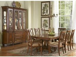dining room furniture. Payless Furniture Beautiful Classic Dining Room Brown Wooden Table And Chairs Cabinet Pendant Lamp Painting