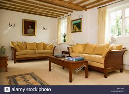 Mahogany Living Room Furniture Ochre Yellow Cushions On Mahogany Framed Sofas In Cream Country
